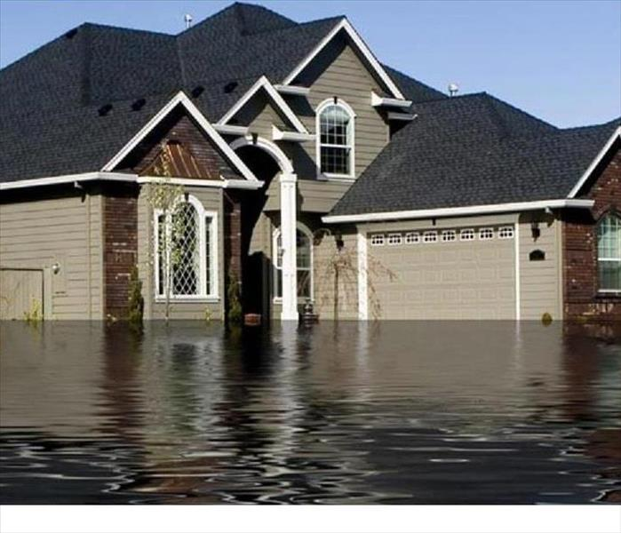 Storm Damage SERVPRO of Woodridge/Bolingbrook Technicians Handle ALL Aspects of Flood Damage Remediation After a Storm